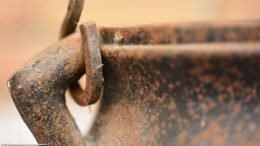 Closeup Of Rust Covered Fireplace Starter Handle