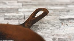 Closeup Of A Rusted Handle On A No Notch Lodge Skillet Size 3