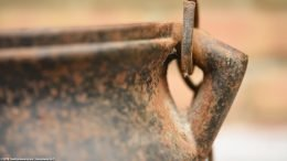 Rusty Handle Attached To A Cape Cod Fireplace Starter
